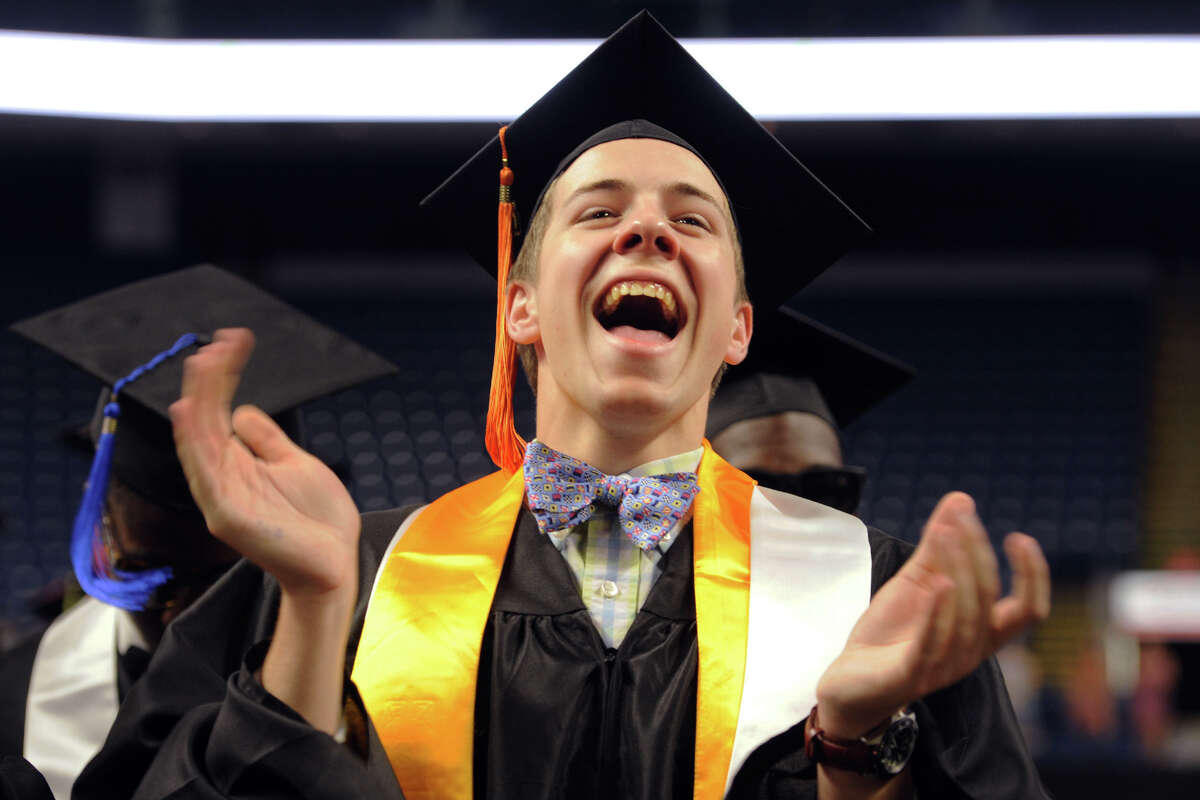 Thomas Pond, a Information Technology & Software Engineering graduate from Fairfield, celebrates during the First Annual Commencement for The Interdistrict Science Magnet Schools at the Fairchild Wheeler Campus, held at the Webster Bank Arena in Bridgeport, Conn. June 14, 2016.