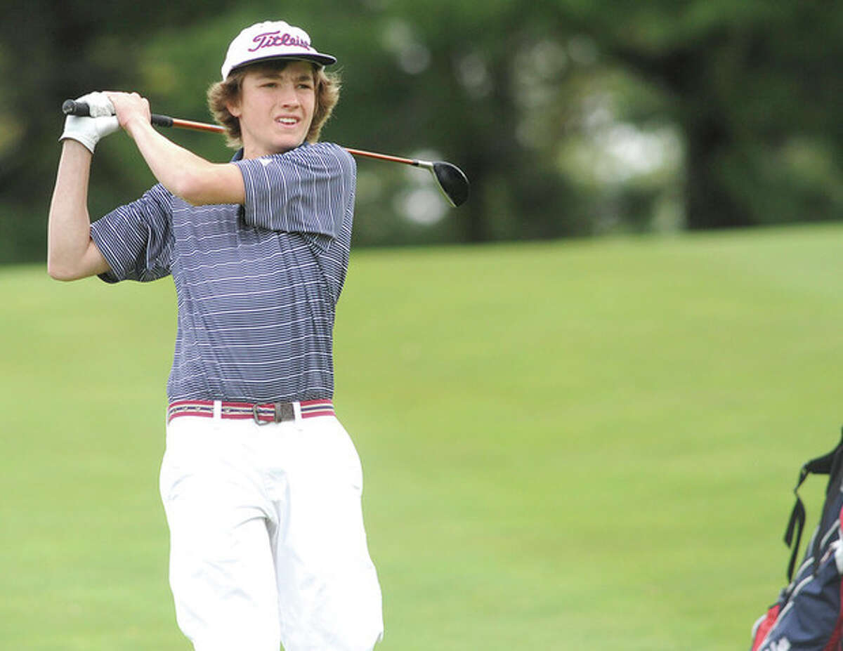 Hour photo/Matthew Vinci Brien McMahon's Miles Nollman watches his drive during Tuesday's Courville Cup match against crosstown rival Norwalk at Shorehaven Golf Club. Nollman and his mates eked out a 158-162 victory -- the closest match since Cup play was initiated -- to retain the trophy for the seventh straight year.