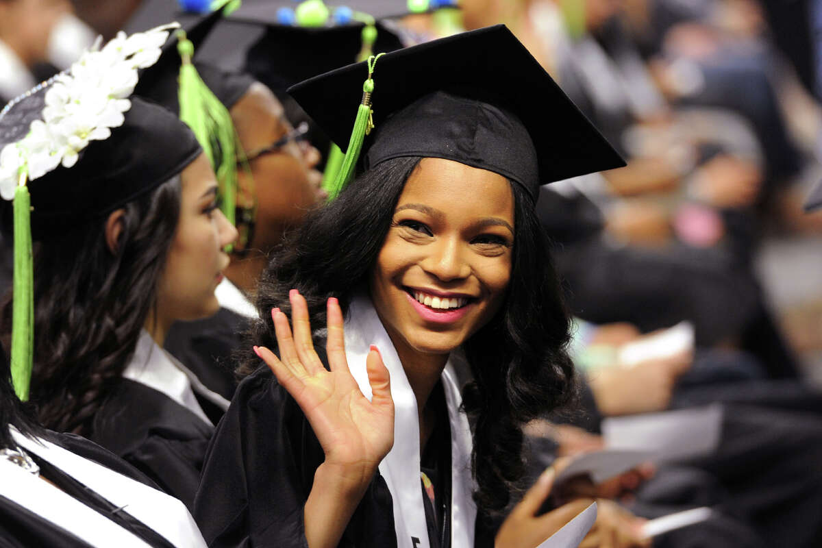Yanique Malabre, a Biotechnology Research & Zoological Sciences graduate waves to family members during the First Annual Commencement for The Interdistrict Science Magnet Schools at the Fairchild Wheeler Campus, held at the Webster Bank Arena in Bridgeport, Conn. June 14, 2016.