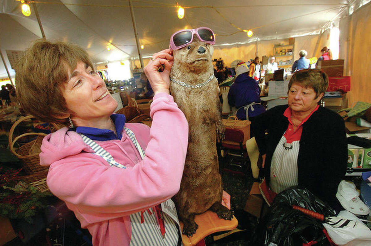 Hour Photo/ Alex von Kleydorff Miks to Sinks Chairperson Anne Hoelzl accesorizes a stuffed otter with sunglasses and a necklace, just one of the unique items offered at this weekends giant sale in Wilton