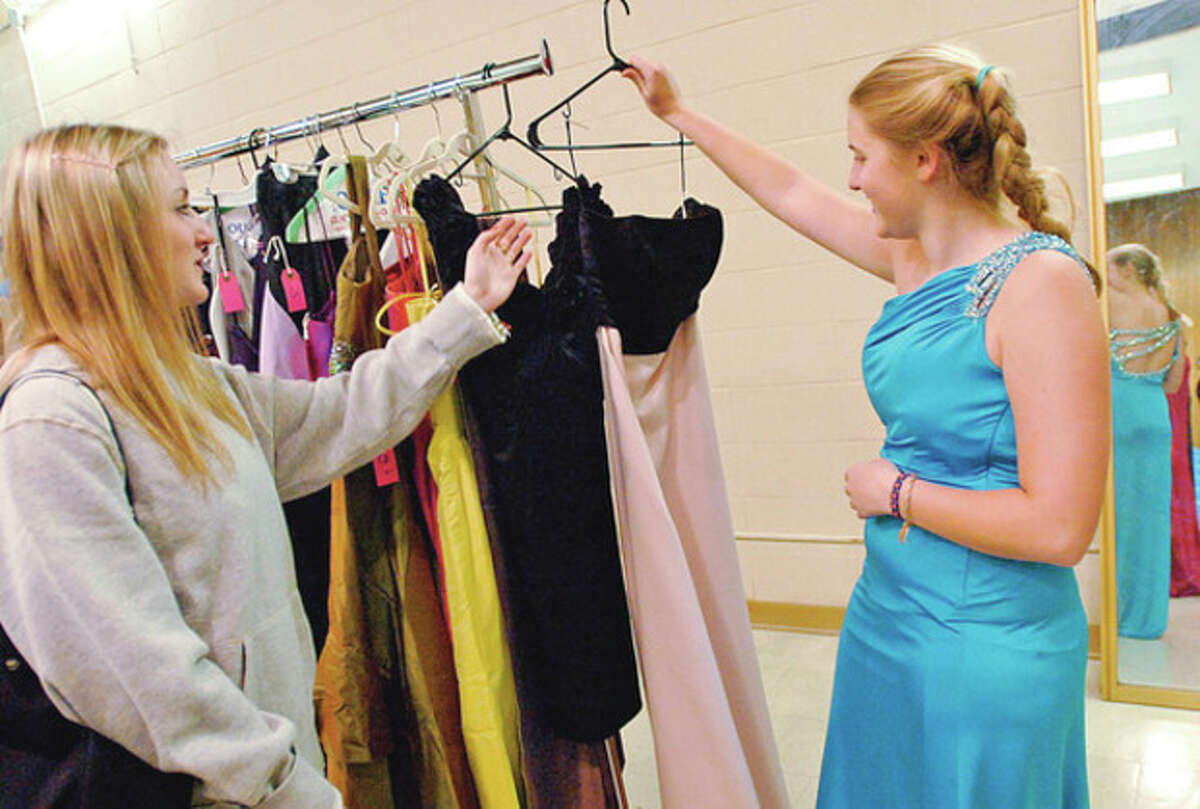 Photos by Erik Trautmann Clockwise from top left, Westhill High School junior Sarah Mandel and Margo Teeter look at dresses during the school's annual prom gown sale on April 27. Westhill seniors Kimberly Thompson and Katie Dicine check out the dress selection. Westhill High School PTO co-president Ann Henning and seamstress Carmen Torrales get dresses ready for the sale.