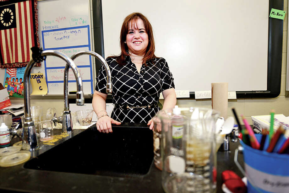 Emily Korn, a science teacher at Cloonan Middle School in Stamford, was chosen from hundreds of applications from across the country to participate in NSTA's year-long professional development fellowship program. Hour photo / Erik Trautmann / (C)2012, The Hour Newspapers, all rights reserved