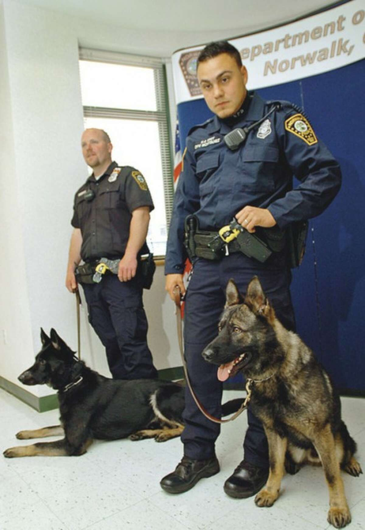 Officer Garrett Gruber with his new police dog, Kimbo and Officer Richard Montanez and his dog, Kai. Hour photo / Erik Trautmann