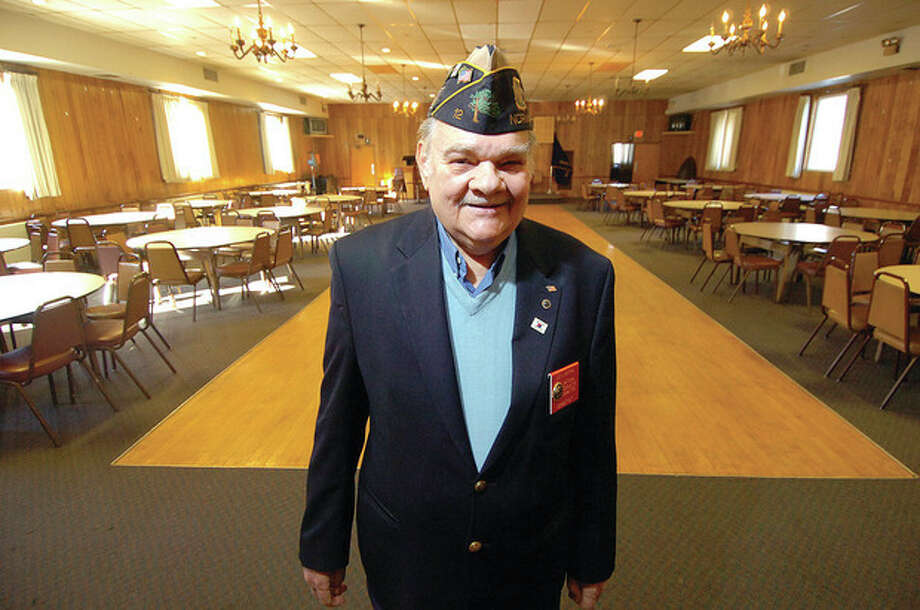 Hour photo / Alex von KleydorffAmerican Legion Post 12 Chairman of the House Comittee Leo Motyka stands in the bigger of two halls at the post on County Street. / 2013 The Hour Newspapers
