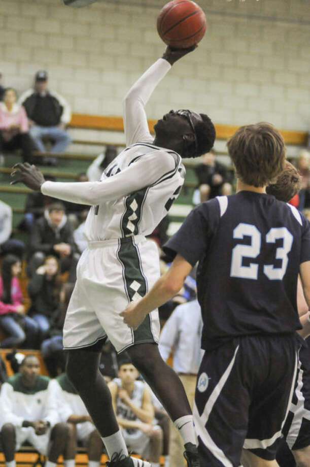 Norwalk's Roy Kane Jr. powers up to the hoop for two points during his team's game against Wilton at Scarso Gym in Norwalk. The Warriors and Bears are both hoping for a rematch, but will first have to knock off their opponents in Saturday's FCIAC basketball quarterfinals at Fairfield Ludlowe High School.Hour photo/John Nash