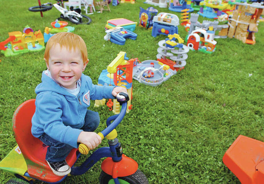 William Heggland, 20 months, finds a toy he likes at the semi-annual Minks to Sinks Spring 2012 rummage sale Saturday in Wilton that benefits FCA (Family & Children's Agency) of Norwalk.Hour photo / Erik Trautmann / (C)2011, The Hour Newspapers, all rights reserved