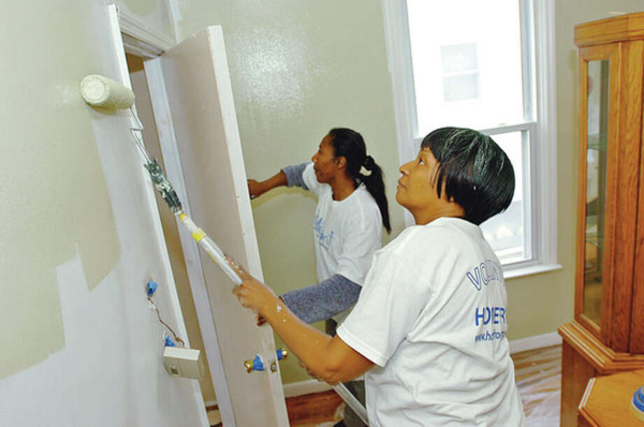 Arletta Tarry, left, volunteers to help with renovations at the home of Diana Maurice, right, Saturday. / (C)2011, The Hour Newspapers, all rights reserved
