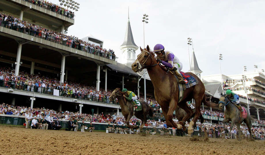 Jockey Mario Gutierrez rides I'll Have Another to victory in the 138th Kentucky Derby horse race at Churchill Downs Saturday, May 5, 2012, in Louisville, Ky. (AP Photo/David J. Phillip) / AP