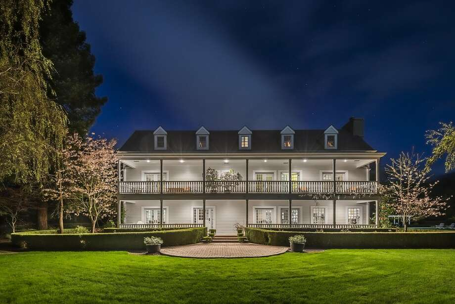 This evening shot of 301 Adobe Canyon Road in Kenwood showcases the nearly symmetrical facade of the two-story residence.