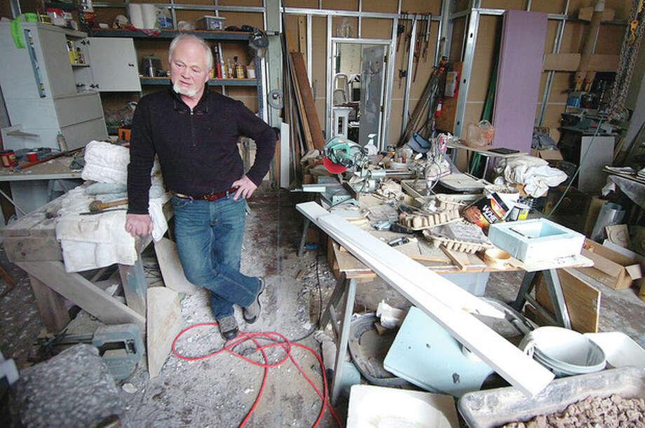 Hour Photo/Alex von KleydorffFiring Circuits Founder Derek Uhlman takes a break from working on a marble sculpture in his studio. / 2013 The Hour Newspapers