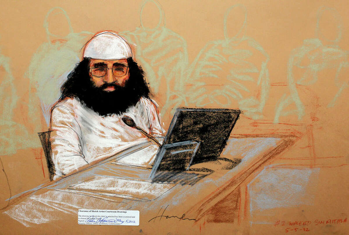 In this photo of a sketch by courtroom artist Janet Hamlin and reviewed by the U.S. Department of Defense, accused Sept. 11 co-conspirator Walid bin Attash is shown while attending his military hearing at the Guantanamo Bay U.S. Naval Base in Cuba, Saturday, May 5, 2012. Khalid Sheikh Mohammed, the self-proclaimed mastermind of the Sept. 11 attacks repeatedly declined to respond to a judge's questions Saturday and Walid bin Attash was briefly restrained at a military hearing as five men, including Khalid Sheikh Mohammed and Walid bin Attash, were charged with the worst terror attack in U.S. history. (AP Photo/Janet Hamlin, Pool)