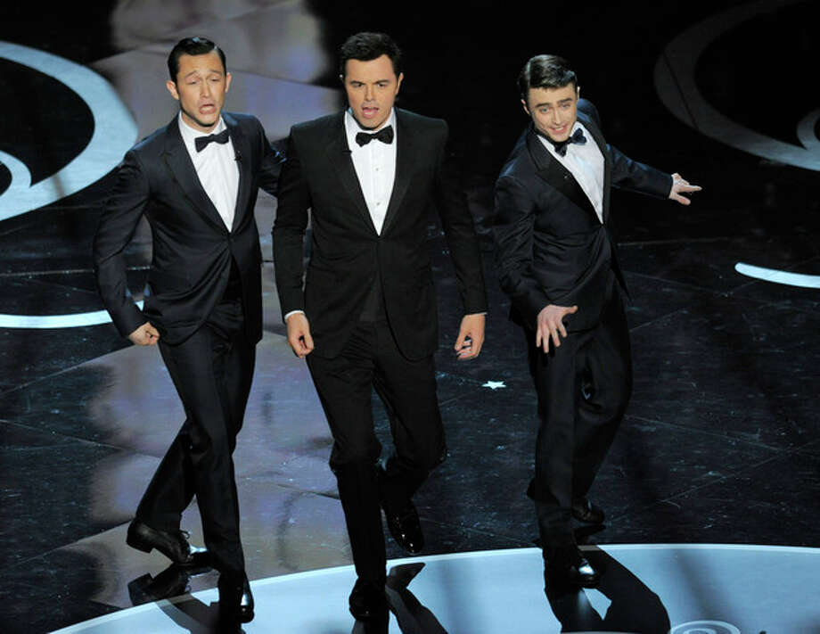 Actors, from left, Joseph Gordon-Levitt, host Seth MacFarlane and Daniel Radcliffe perform during the Oscars at the Dolby Theatre on Sunday Feb. 24, 2013, in Los Angeles. (Photo by Chris Pizzello/Invision/AP) / Invision