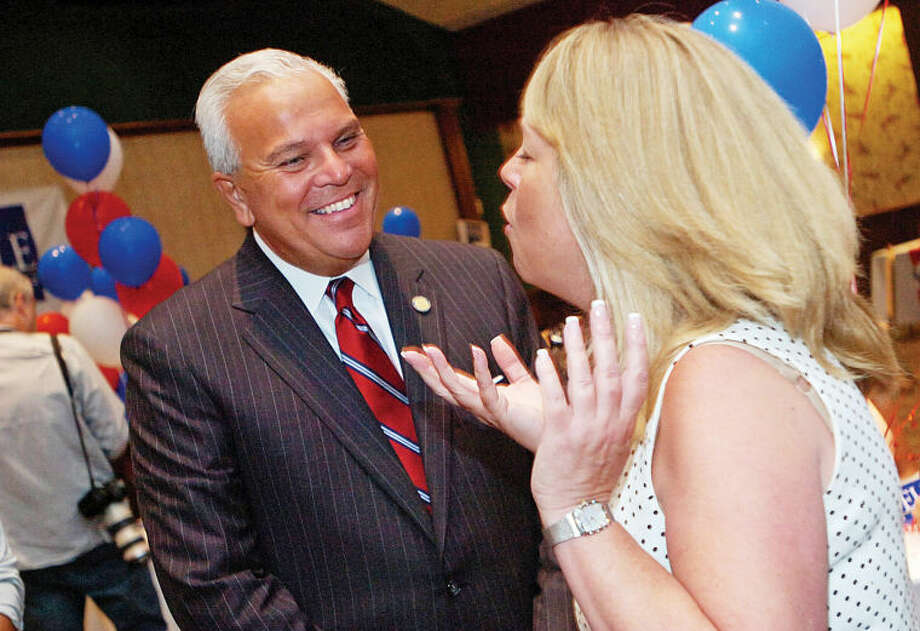 Former Lt. Governor Michael Fedele talks with supporter Cathy Freccia at the Italian Center in this file photo from August 2010.