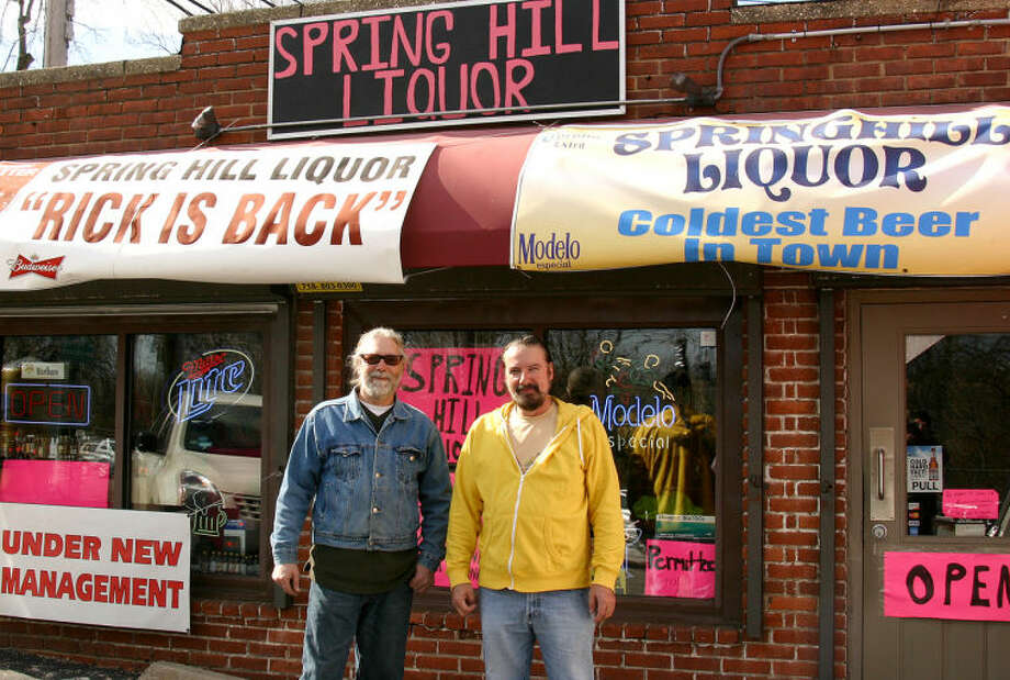 Hour photo / Chris Bosak Rick Agvent, right, and business partner Robert Homiak stand in front of their store Spring Hill Liquor in Norwalk.