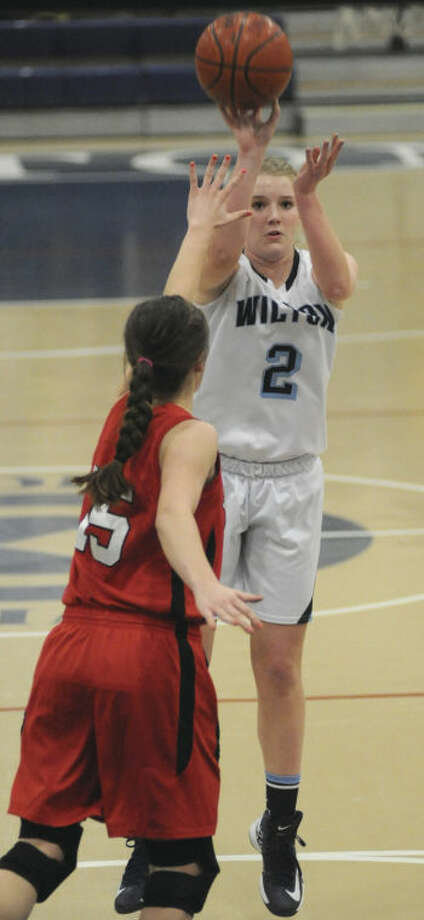 Hour photo/John NashWilton High School's Erin Cunningham (2) puts up a shot over the defense of Branford's Amber Markovitz during the second quarter of Monday's Class L first round playoff game. The fifth-seeded Warriors breezed to a 56-33 victory.