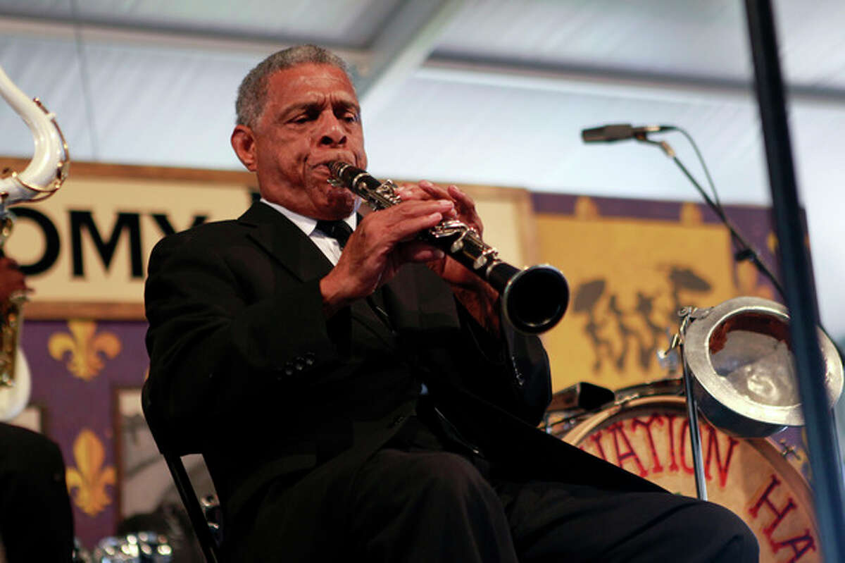 In this Saturday, May 5, 2012 photo, the Preservation Hall Jazz Band performs at the New Orleans Jazz and Heritage Festival in New Orleans. For five decades, Preservation Hall has served up New Orleans jazz for music lovers the world over. The New Orleans Jazz and Heritage Festival, on its closing weekend, marked that achievement by showcasing the world-renowned Preservation Hall Jazz Band in concert twice. (AP Photo/Gerald Herbert)