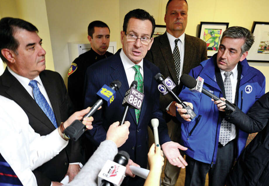 Hour photo / Erik TrautmannGov. Dannel P. Malloy discusses gun safety legislation at a press briefing in Stamford Tuesday after meeting with Stamford Mayor Michael Pavia, Stamford Police Chief Jonathan Fontneau and other local officials to discuss his gun violence prevention proposal. / (C)2012, The Hour Newspapers, all rights reserved