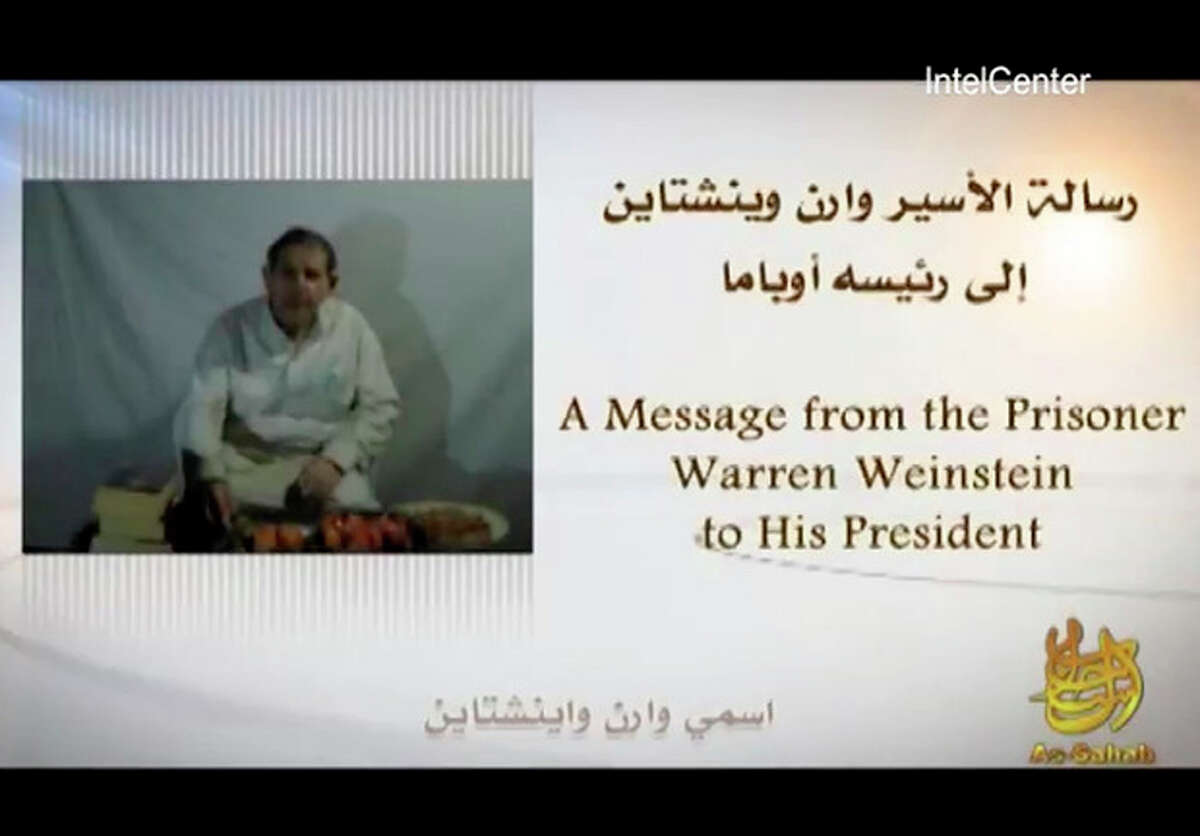 In an image provided by IntelCenter a still from the video released Sunday by al-Qaida of American hostage Warren Weinstein Weinstein said said he will be killed unless President Barack Obama agrees to the militant group's demands. (AP Photo/IntelCenter) Mandatory Credit No Sales