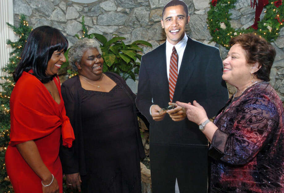 Gloria DePina, Elaine Mitchell and Ellen Camhi (far right) chat around a life-size Obama decoration at the Inaugural Gala Honoring Barack Obama and Jim Hims held at Continental Manor in Norwalk in this file photo from 2009.