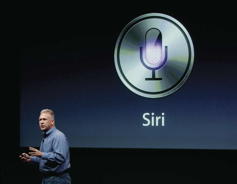 AP photo/Paul Sakuma Apple's Phil Schiller talks about Siri with the new Apple iPhone 4S during an announcement at Apple headquarters in Cupertino, Calif., Tuesday. / AP