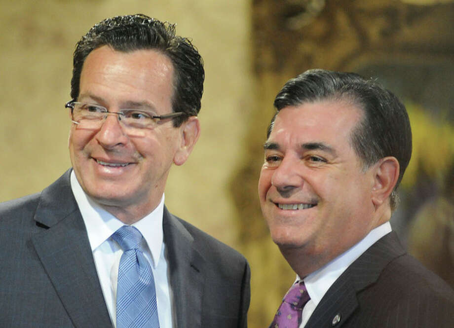 Connecticut Governor Dannel Malloy and Stamford Mayor Michael Pavia Monday night at the Citizen of the Year awards dinner at the Italian Center in Stamford. photo/Matthew Vinci