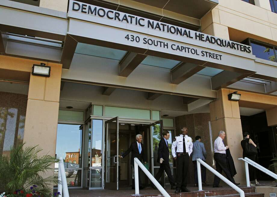People stand outside the Democratic National Committee (DNC) headquarters in Washington, Tuesday, June 14, 2016. Photo: Paul Holston, Associated Press