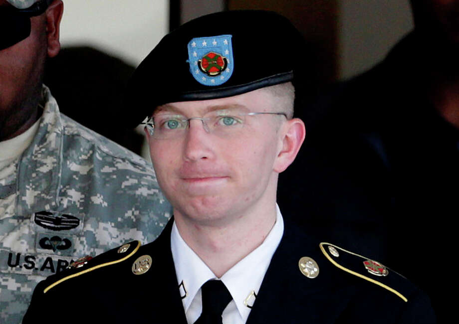 FILE - In this June 25, 2012 file photo, Army Pfc. Bradley Manning, right, is escorted out of a courthouse in Fort Meade, Md. The Army private charged in the largest leak of classified material in U.S. history says he sent the material to WikiLeaks to enlighten the public about American foreign and military policy on Thursday, Feb. 28, 2013. (AP Photo/Patrick Semansky, File) / AP