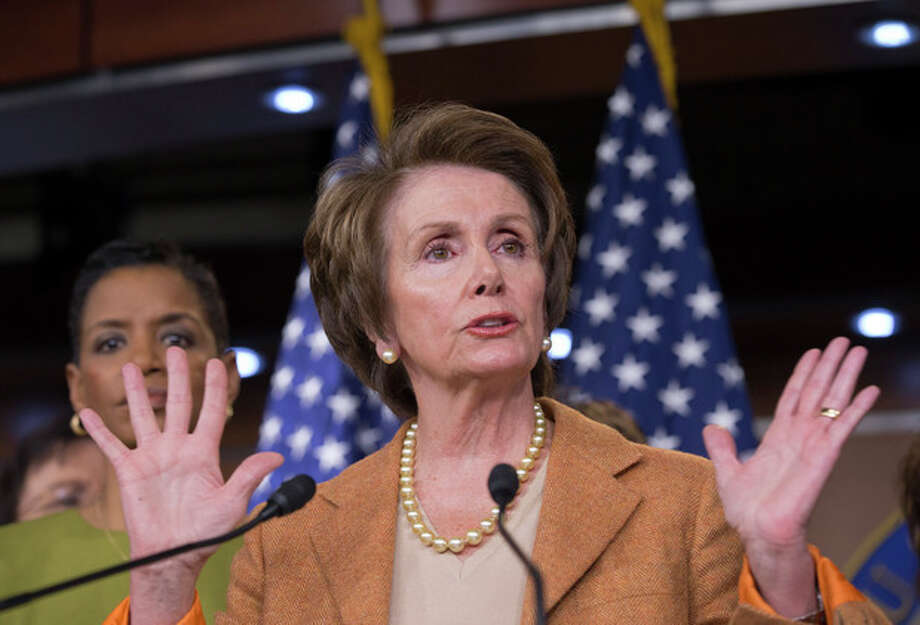 In this Feb. 28, 2013, photo, House Minority Leader Nancy Pelosi of Calif., joined by fellow House Democratic women, gestures during a news conference on Capitol Hill in Washington, to talk about the impending automatic spending cuts that will most likely take effect late Friday, March 1. (AP Photo/J. Scott Applewhite) / AP
