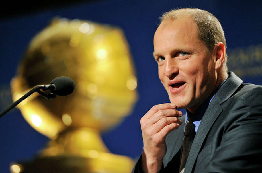 """Presenter Woody Harrelson gives his new movie """"Rampart"""" a plug onstage during nominations for the 69th Annual Golden Globe Awards, Thursday, Dec. 14, 2011, in Beverly Hills, Calif. The Golden Globe Awards will be held on Sunday, Jan. 15, 2012, in Beverly Hills, Calif. (AP Photo/Chris Pizzello) / AP"""