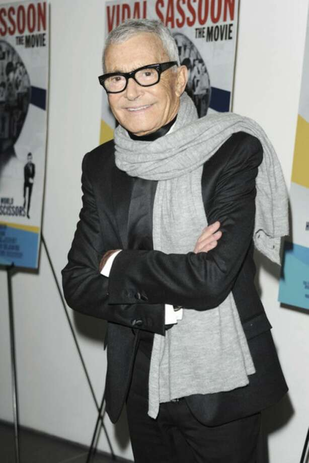 "In this Feb. 9, 2011 file photo released by Starpix, hair designer and businessman, Vidal Sassoon, stops for a photo at a special screening of ""Vidal Sassoon: The Movie,"" in New York. Sassoon, whose 1960s wash-and-wear cuts freed women from endless teasing and hairspray died Wednesday, May 9, 2012, at his home. He was 84. (AP Photo/Starpix, Dave Allocca)"