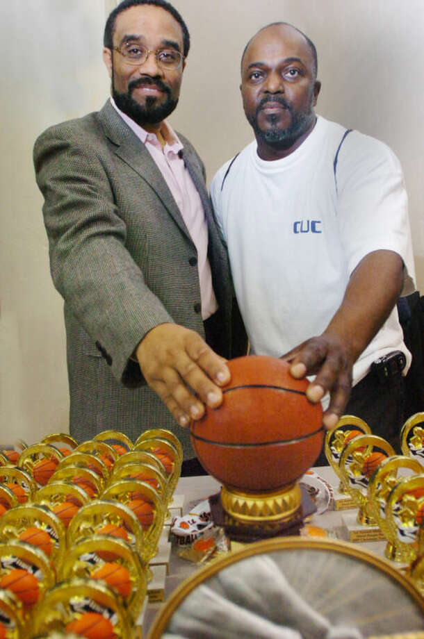 Larry Johnson, founder of Shoot Hoops Not Guns with Representitive Bruce Morris at the event held at Norwalk's Brien McMahon High School on Thursday/hour photo matthew vinci
