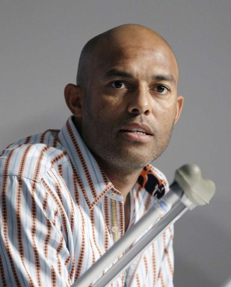 New York Yankees closer Mariano Rivera, who suffered a season-ending leg injury shagging fly balls in the outfield before the Yankees' baseball game against Kansas City last week, speaks to reporters before the Yankees' game against the Tampa Bay Rays in New York, Wednesday, May 9, 2012. (AP Photo/Kathy Willens)