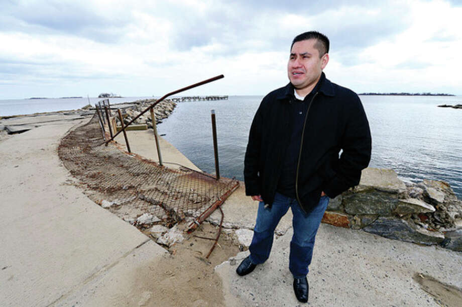 Hour photo / Erik TrautmannNorwalk resident Misael Garcia hopes the Recreation and Parks Department will have the beach in good repair by the end of April despite severe storm damage from Sandy and subsequent storms. / (C)2013, The Hour Newspapers, all rights reserved