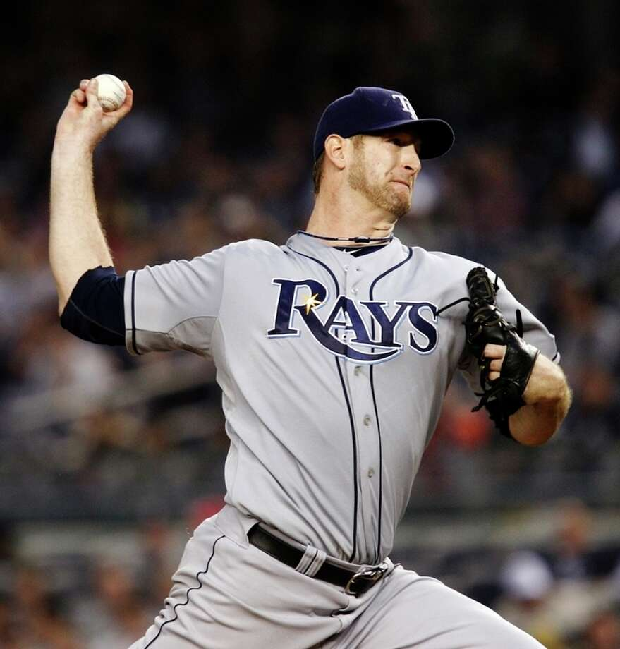 Tampa Bay Rays starting pitcher Jeff Niemann winds up in the second inning against the New York Yankees during their baseball game at Yankee Stadium in New York, Wednesday, May 9, 2012. (AP Photo/Kathy Willens) / AP