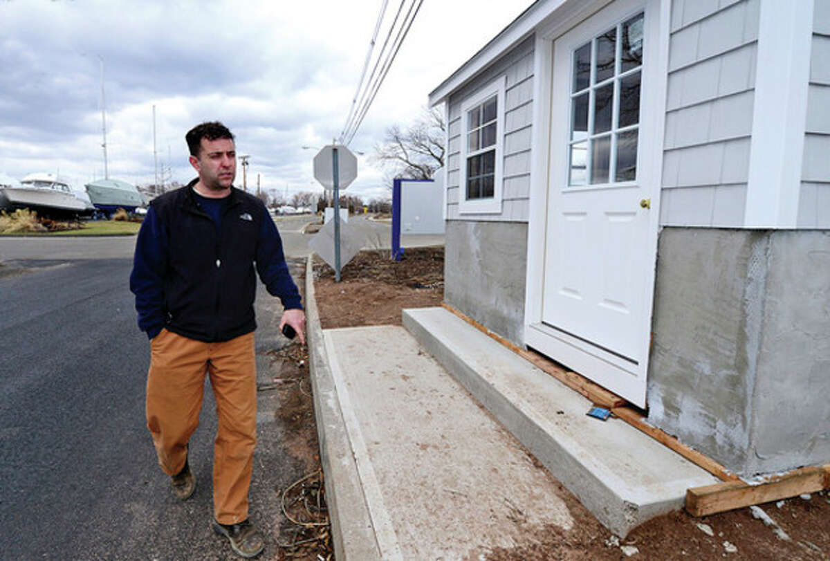 Parks and Recreation Department Parks Superintendent Ken Hughes eyes the new guard house at Calf Pasture Beach which repalce the one damaged by Hurricane Sandy. The Norwalk Recreation and Parks Department plans to have the beach in good repair by the end of April despite severe storm damage from Sandy and subsequent storms. Hour photo / Erik Trautmann