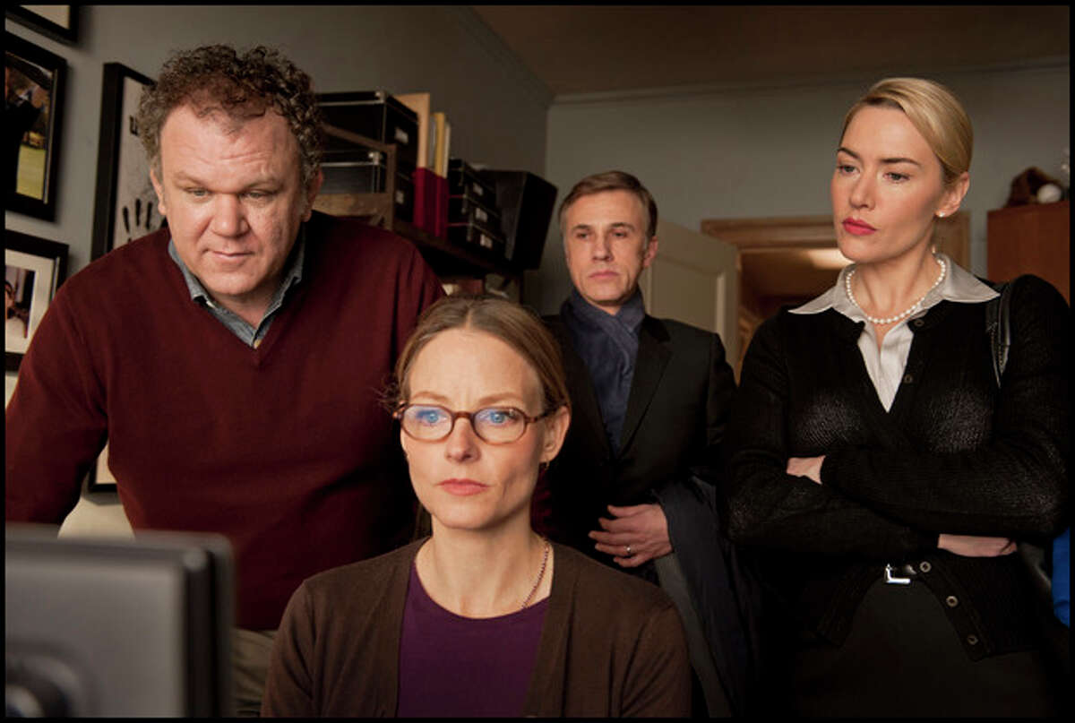 """In this film image released by Sony Pictures Classics, from left, John C. Reilly, Jodie Foster, Christoph Waltz and Kate Winslet are shown in a scene from """"Carnage."""" Foster and Winslet were nominated Thursday, Dec. 15, 2011 for a Golden Globe award for best actress in a musical or comedy for their roles in the film. (AP Photo/Sony Pictures Classics, Guy Ferrandis)"""