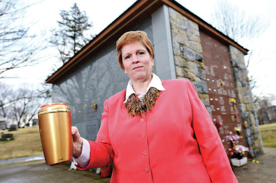Hour photo / Erik TrautmannAbove, Shelly Timber, general manager at Riverside Cemetery, reports that 10 bronze vases, worth about $500 each, were stolen from a community mausoleum at the cemetery on Sunday. / (C)2013, The Hour Newspapers, all rights reserved