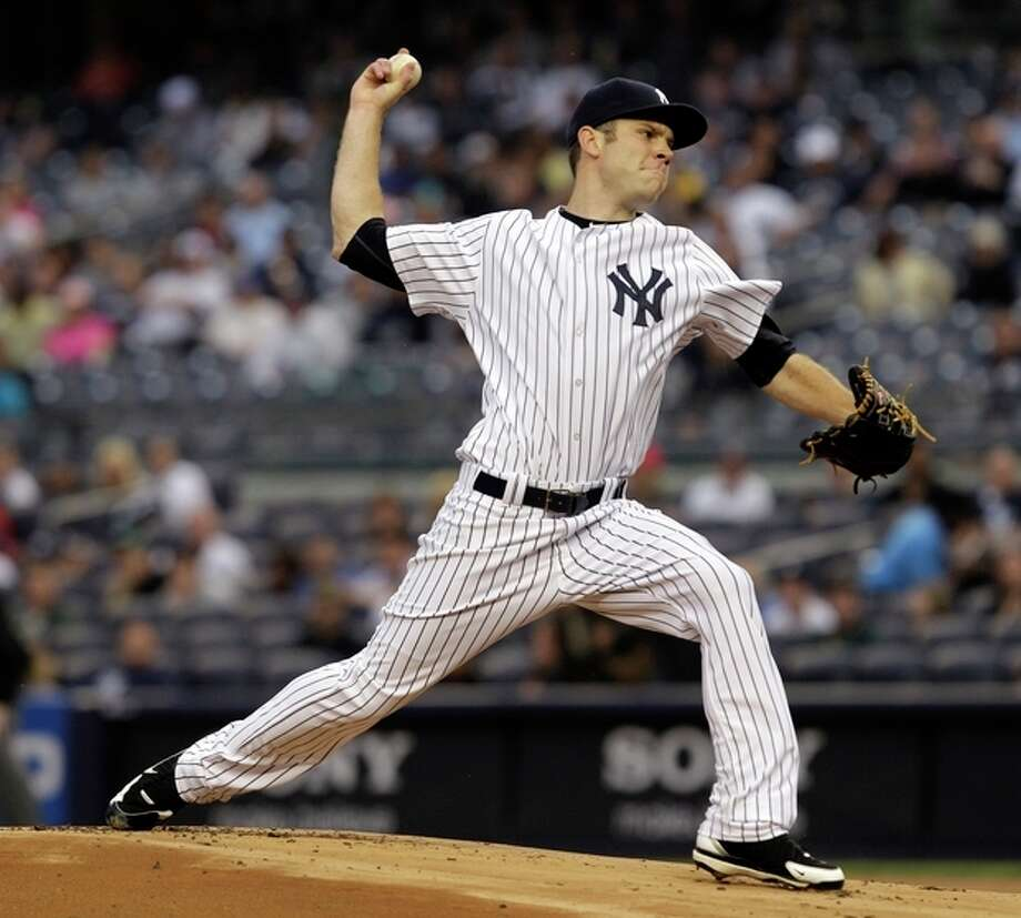 New York Yankees starting pitcher David Phelps delivers against the Tampa Bay Rays in the second inning during their baseball game at Yankee Stadium in New York, Wednesday, May 9, 2012. (AP Photo/Kathy Willens) / AP