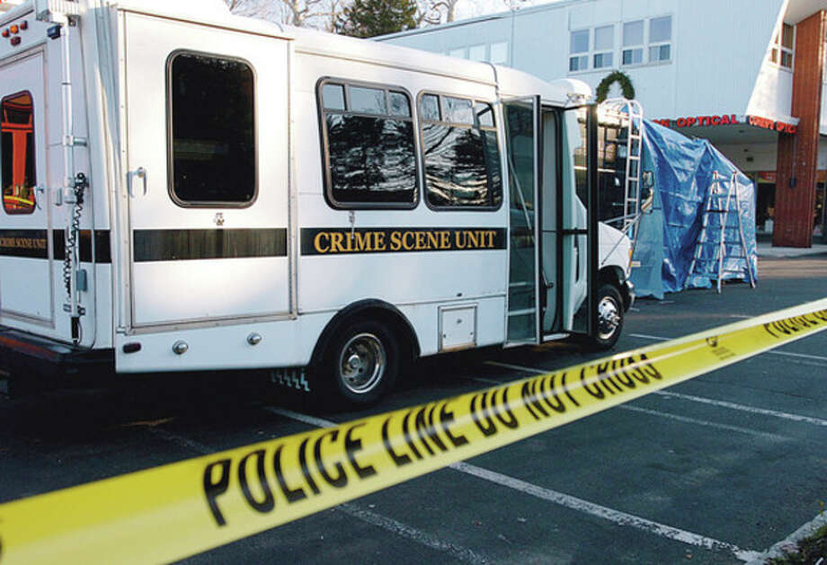 State and local police set up at the crime where a Westport Jeweler, 59-year-old Yekutiel Zeevi, was murdered at his office in Compo Shopping Center last night. Hour photo / Erik Trautmann / (C)2011, The Hour Newspapers, all rights reserved