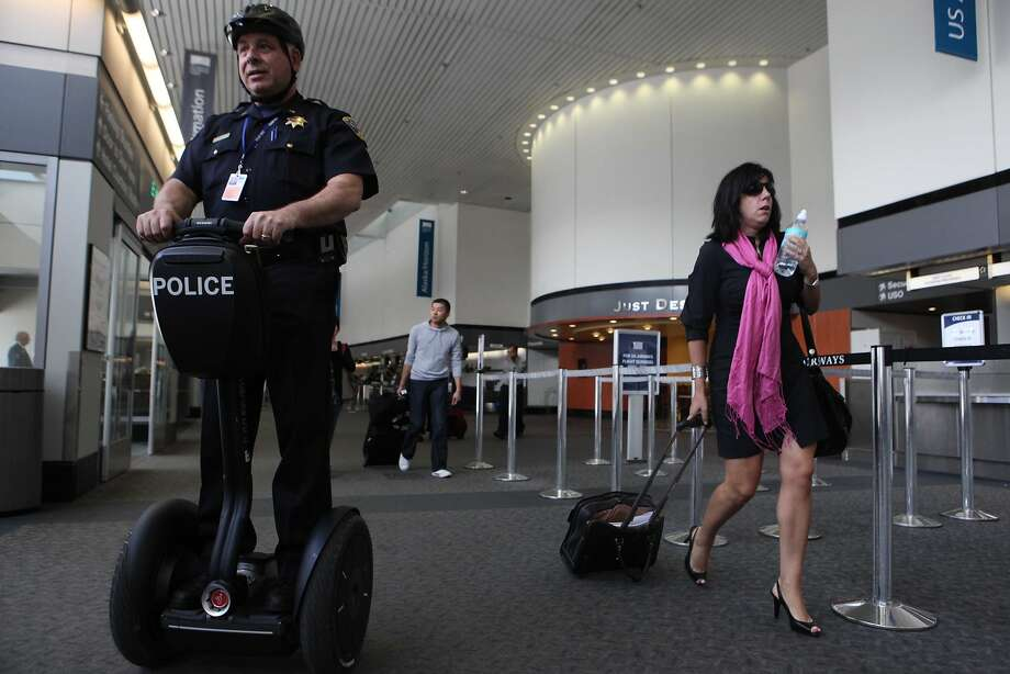San Francisco police officer, Lt. Tom Buckley, tries out a Segway scooter at the airport in 2009. The airport is experiencing a boom in officer transfer requests this year. Photo: Mike Kepka, The Chronicle