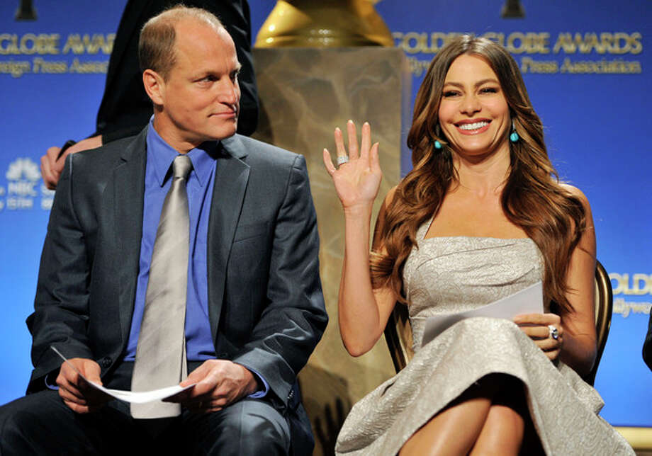 Presenter Sofia Vergara waves to photographers alongside fellow presenter Woody Harrelson before they announced nominations for the 69th Annual Golden Globe Awards, Thursday, Dec. 14, 2011, in Beverly Hills, Calif. The Golden Globe Awards will be held on Sunday, Jan. 15, 2012, in Beverly Hills, Calif. (AP Photo/Chris Pizzello) / AP