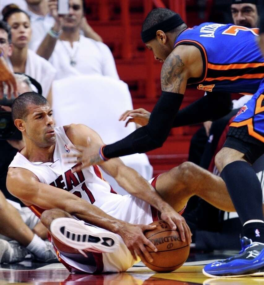 Miami Heat forward Shane Battier, left, and New York Knicks forward Carmelo Anthony battle for a loose ball during the first half of an NBA basketball game in the first round of the Eastern Conference playoffs, Wednesday, May 9, 2012, in Miami. (AP Photo/Wilfredo Lee) / AP