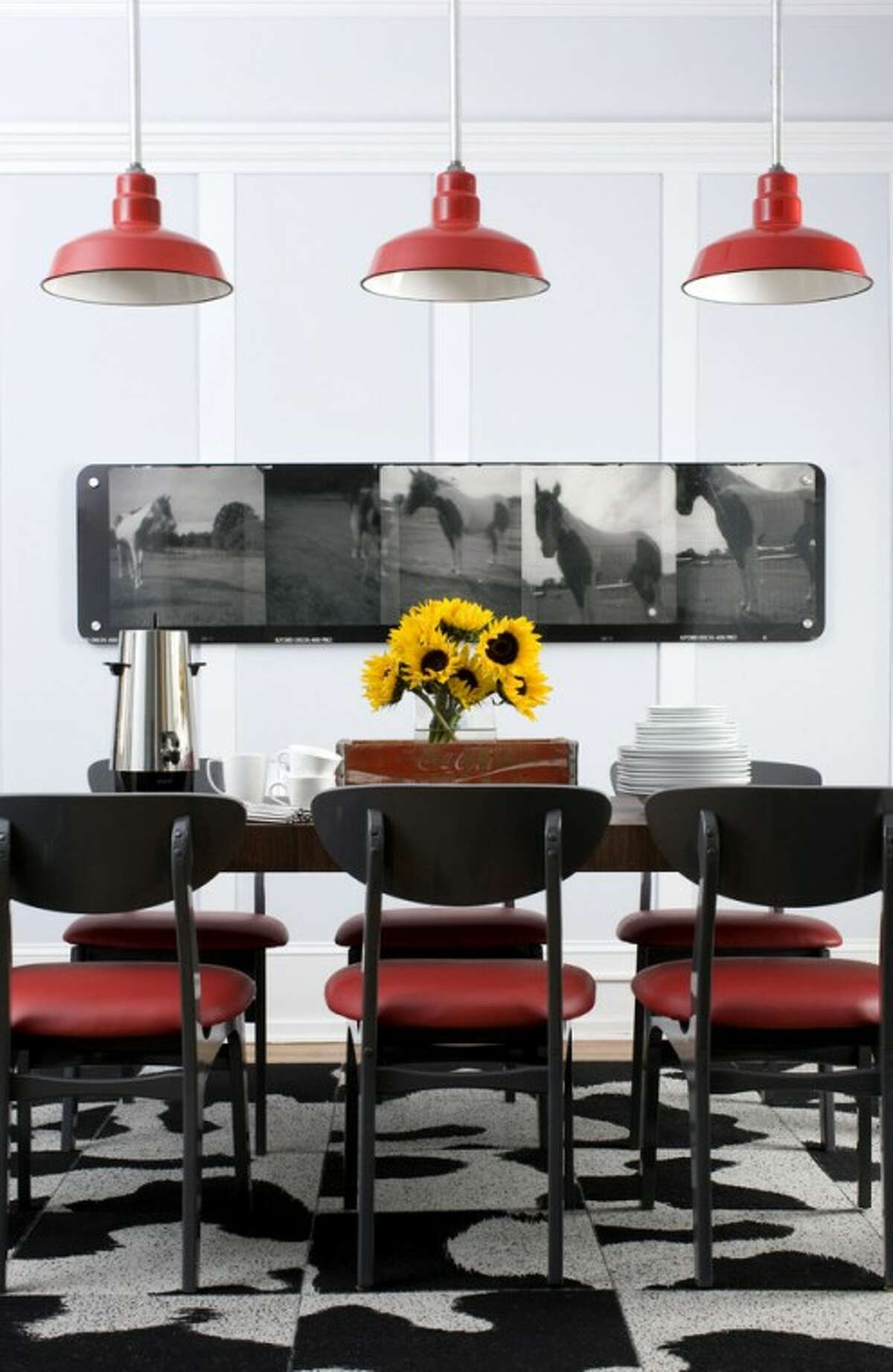 In this undated handout image released by Brian Patrick Flynn, the dining room designed by Brian Patrick Flynn demonstrates how the designer balances space vertically by grounding a room with pendant lighting. (AP Photo/Brian Patrick Flynn Designs, Sarah Dorio)