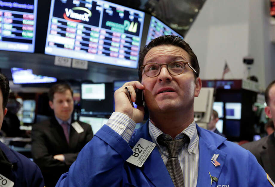 Trader Leon Montana, right, works on the floor of the New York Stock Exchange Thursday, Feb. 28, 2013. The stock market pushed higher Thursday afternoon, sending the Dow tantalizingly close to a record high. (AP Photo/Richard Drew) / AP
