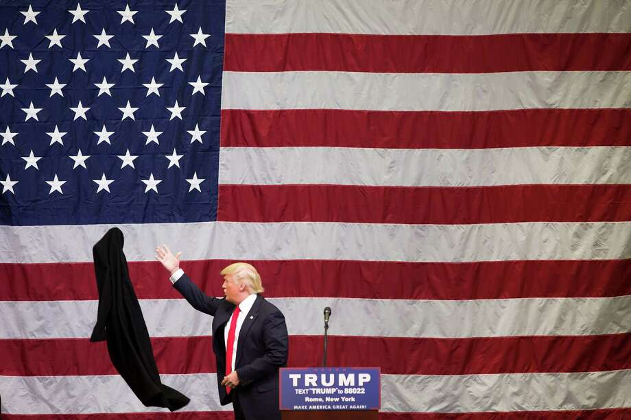 Donald Trump tosses his coat aside during a fly-in campaign stop at the Griffiss International Airport in Rome, N.Y., April 12, 2016. Trump's's message on trade resonates deeply with many voters upstate, where the loss of manufacturing jobs has been pronounced, and polls are suggesting that the business mogul will win New York's primary, a week from today. (Nathaniel Brooks/The New York Times) Photo: NATHANIEL BROOKS, STR / NYT / NYTNS