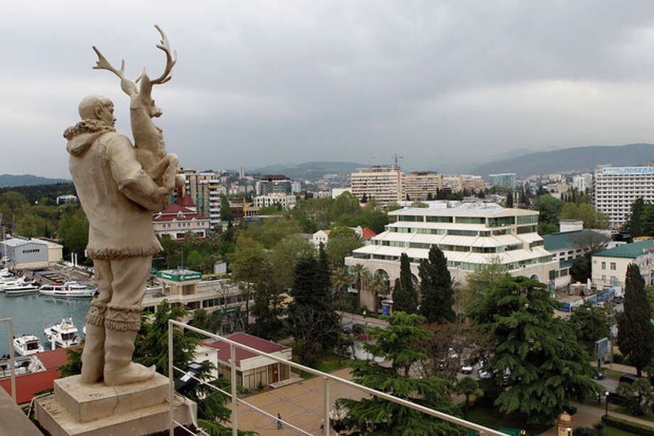 In this photo taken on Thursday, May 19, 2011, an old Soviet style statue of a reindeer breeder, left, is seen over the Black Sea resort of Sochi, southern Russia. Russia's secret service said Thursday, May 10, 2012, that it had foiled terror attack plans in the Black Sea resort of Sochi ahead of the 2014 Winter Games. The FSB said it suspects the attacks were being masterminded by Doku Umarov. The FSB also said that it suspects that Umarov has close links to the secret service in Georgia. .(AP Photo/Alexander Zemlianichenko, file) / AP