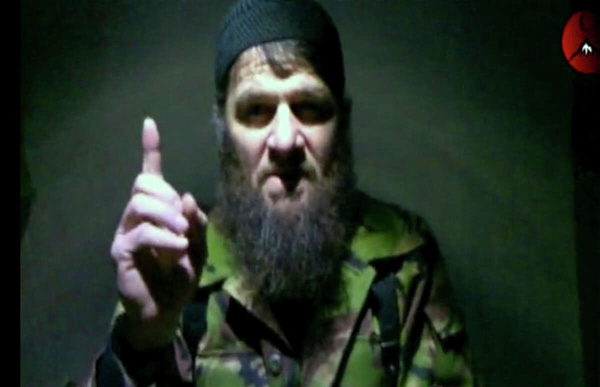 This image taken from video and released Monday, Feb. 7, 2011 by The Kavkaz Center, a website affiliated with Chechen rebels, shows insurgent leader Doku Umarov speaking in a video in which he claims responsibility for deadly suicide bombing at Russia's largest airport. It was not clear when or where the video was recorded. Russia's secret service said Thursday, May 10, 2012, that it had foiled terror attack plans in the Black Sea resort of Sochi ahead of the 2014 Winter Games. The FSB said it suspects the attacks were being masterminded by Doku Umarov. The FSB also said that it suspects that Umarov has close links to the secret service in Georgia. (AP Photo/The Kavkaz Center) NO SALES