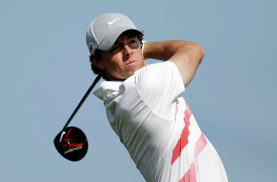 Rory McIlroy, of Northern Ireland, watches his tee shot on the 10th hole during the first round of the Honda Classic golf tournament, Thursday, Feb. 28, 2013, in Palm Beach Gardens, Fla. (AP Photo/Wilfredo Lee) / AP