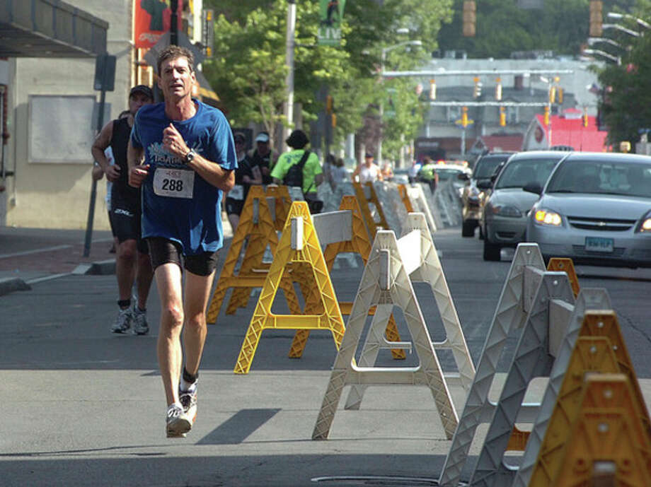 Photo by Alex von Kleydorff. Runners head for the finish of the last leg of the Kic-It Triathlon. / 2011 The Hour Newspapers
