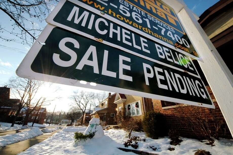 In this Saturday, Jan. 5, 2013, photo, a sale pending sign is outside of a house in Mount Lebanon, Pa. A measure of the number of Americans who signed contracts to buy homes rose in January from December to the highest level in more than 2 ½ years. The increase suggests sales of previously occupied homes will continue rising in the coming months. (AP Photo/Gene J. Puskar) / AP
